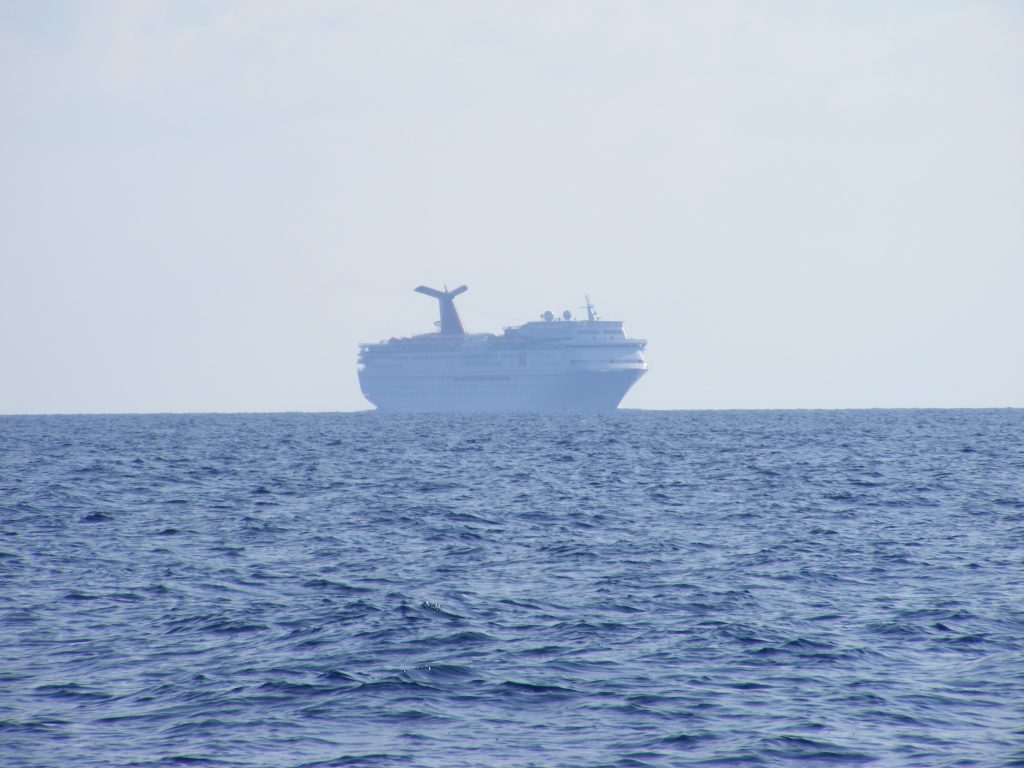 Carnival cruise ship approaching to pass us astern.