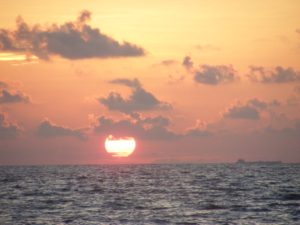 Sunrise in the Gulf of Mexico. Don't miss the ship in the image.