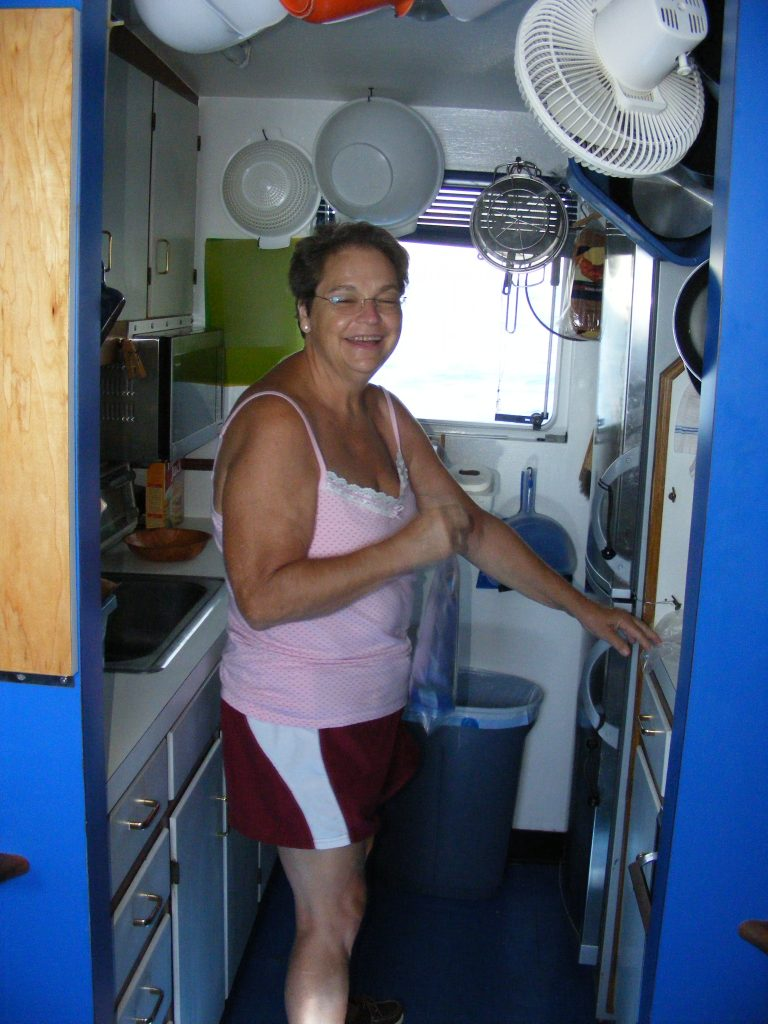 Nancy in the galley of M/V Vagabond.