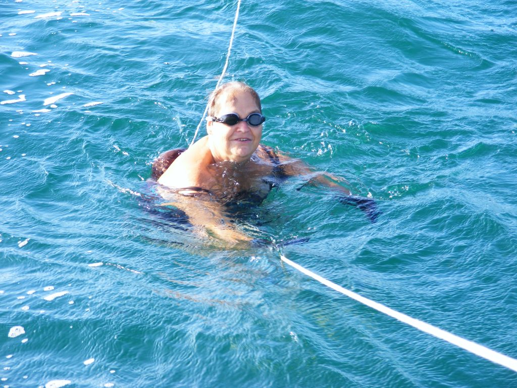 Nancy swimming off the stern.
